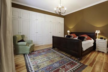 Vintage master bedroom with wooden floor