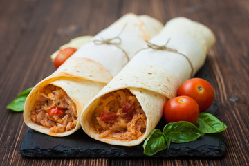 Mexican tortilla with chicken, rice, beans and tomatoes