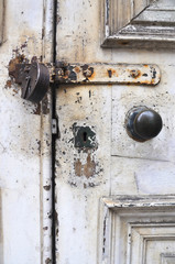 Old English front door  and rusty padlock