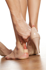 Closeup of a woman's heel with a blister plaster on