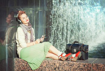 Hipster fashion girl listening music outdoor