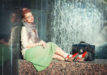 Hipster fashion girl in green skirt