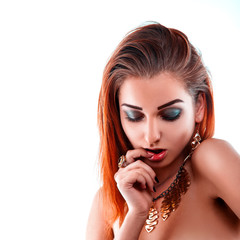 Portrait of beautiful red hair woman with healthy skin in studio