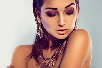 Horizontal portrait of fashion model with make up and accessorie