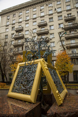 Monument from abstract pictures and gold frames