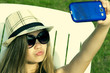 caucasian young girl sunbathing in hammock rental