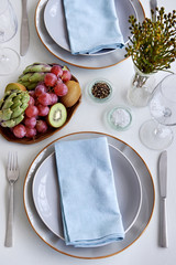 Party place setting with napkins and fruit centrepiece