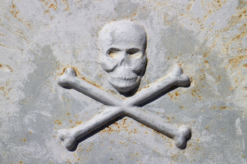 Death head on ancient tombstone, Hvar island, Croatia