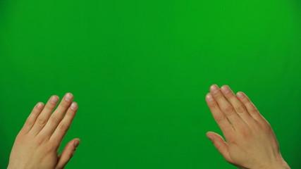 Sliding hands on a green screen.FULL HD.