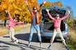Car trip on autumn family vacation, mother and kids travel