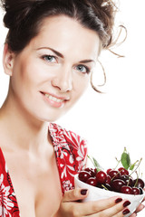 woman with cherries over white