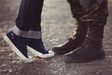 Soldier boots saying goodbye his girlfriend in jeans