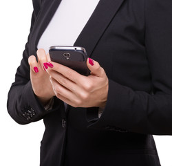 Businesswoman touching smartphone, holding in her hands