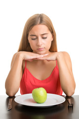 Woman Looking at a Plate With an Apple