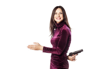young beautiful woman offers the hand with a gun behind her back