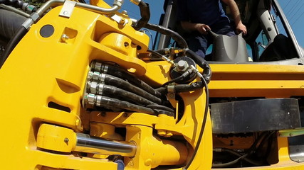 A Worker Operates Heavy Machinery