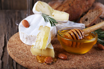 Camembert cheese, nuts, honey and bread
