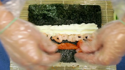 Making sushi roll top view