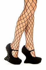 Sexy legs in fishnet stockings and fetish high heels