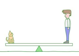 シーソーに乗る男性と猫