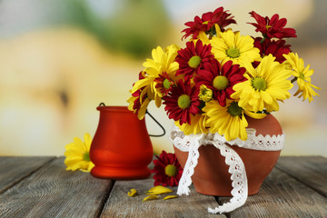 Beautiful chrysanthemum in pot with candlestick