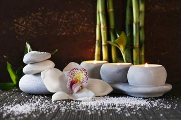Spa set on bamboo mat on dark background