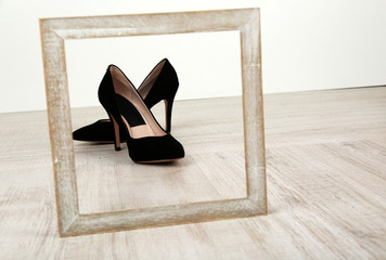 Black women shoes with frame on floor