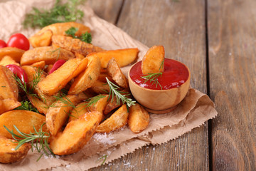 Homemade fried potato with spices and herbs
