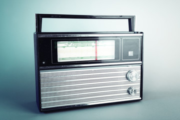 Old radio set on blue background