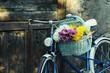 Obrazy na płótnie, fototapety, zdjęcia, fotoobrazy drukowane : Old bicycle with flowers in metal basket