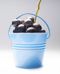 bucket full with fruits and grape