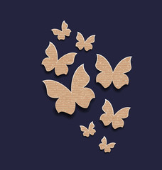 Dark background with butterflies made in carton paper