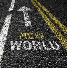 new world and arrow on the asphalt road