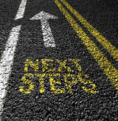 next steps and arrow  on the asphalt road
