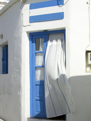 Greek Island doorway with curtain Kimilos Greece