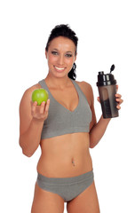 Woman after her training, drinking protein shake