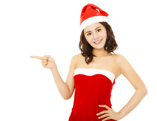 smiling young woman wearing christmas suit with santa cap over w