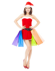 Christmas santa woman standing and holding gift bags over white
