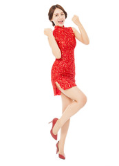 happy asian young woman with cheongsam making a victory pose