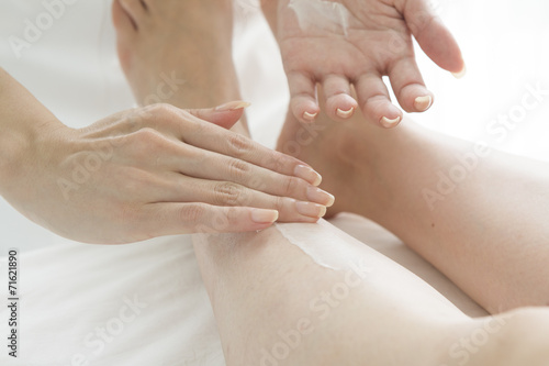 poster of Esthetician to apply the cream to the foot