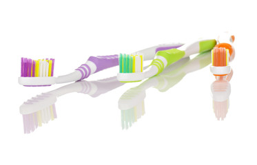Three Colourful Toothbrushes