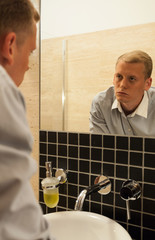 Man struggling with addiction in the bathroom