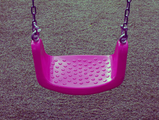 Pink swing on green grasses, Filtered colors