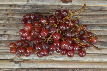 Tasty grapes on bamboo place