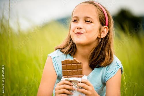 Girl enjoying chocolate - 71623445