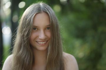 teen girl smiling on outdoor walk