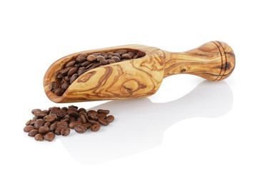 olive scoop with roasted coffee beans