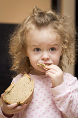 Little girl with loaf of bread