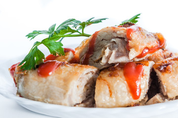 Meatloaf with ketchup and parsley