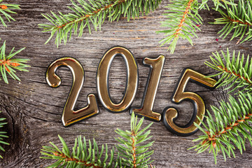 New Year background with  fir decorations on old wooden table